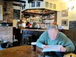 Johnny reviewing our maps in The Jolly Farmer